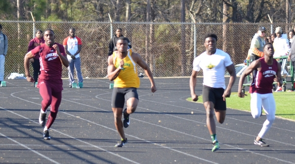 Richmond's Jaleen Baldwin (yellow) and Dante Miller (white) took second and first in the 100-meter dash at Pinecrest.