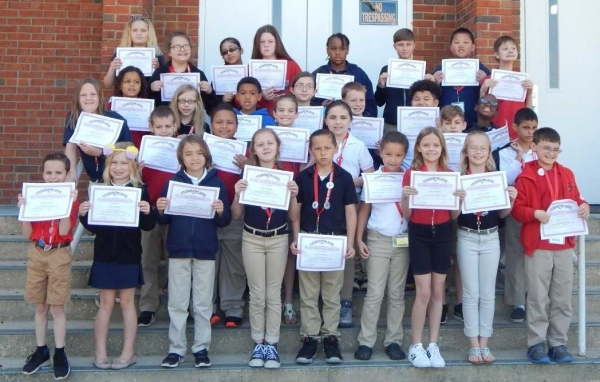 Students making the A Honor Roll. Front: Caden Locklear, Alyssa Weaver, Joshua Russell, Annika Briggs, Victor Nguyen, Larissa Taylor, Sophia Garner, Anna Stogner and Thomas Quick. Second row: Hope McFayden, Victor Pankey, Cardiyea Crank, Aalyssa Chavis, Samantha Langley, Elijah Hernandez and Warren Terry. Third row:  NaSean McBride, Makayla Wilson, Kimahri Johnson, Diana McLester, James Robinson, Willie Breeden and Rayshawn Huff. Fourth row: Carley Gulledge, Alissa Smith, Brianna Menchaca, Bree Rape, Janashia Scott, Dougie Dickinson, Andrew He and Blake Gamble. Absent from picture: Jose Mendoza Ramirez and Drew Stein.
