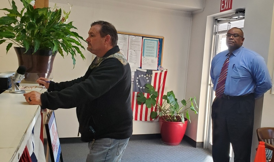 School board member Ronald Tillman, right, waits in line behind Lee Berry at the Richmond County Board of Elections as they file for office on Tuesday.