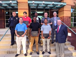 The graduates of Richmond Community College's Basic Law Enforcement Training program stand with the college president and the BLET training officers. Pictured are, from left, first row, Dylan Scherer, Amante Carswell, Trinity Jernigan and Dr. Dale McInnis; from left, second row, Rockingham Patrol Sergeant Ronnie Brigman, Haiden Evans, Calvin House, John A. Martin Jr. and Rockingham Police Chief Billy Kelly. Not pictured is BLET graduate Makenzie Davis.