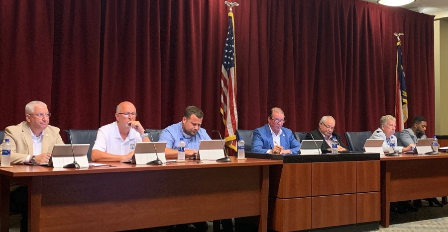 The Richmond County Board of Commissioners listens to updates by County Manager Bryan Land during the September meeting last week.