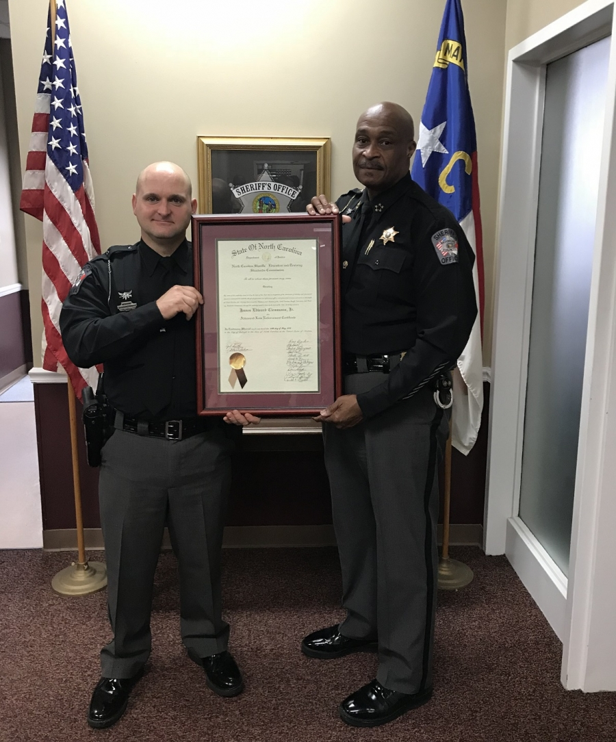Sheriff James Clemmons presents Deputy Braxton Greene his Advanced Law Enforcement certificate on Monday.