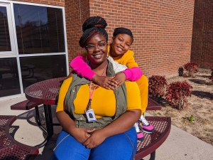 Richmond Community College Pre-Nursing student Latecia Smith and her daughter, Sanira, have worked together to make their virtual classrooms at home a good learning environment.