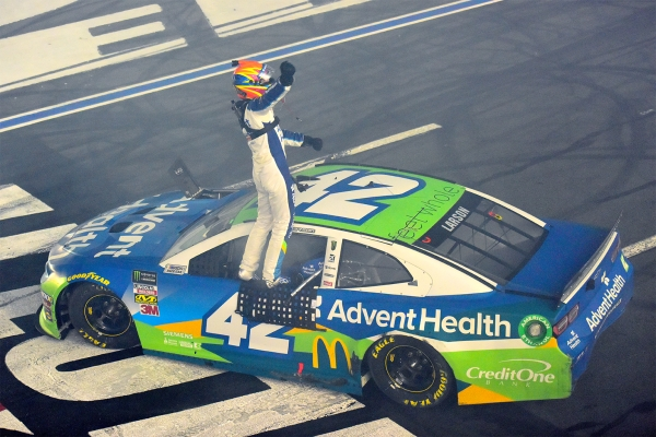 Kyle Larson, driver of the #42 Advent Health Chevrolet, celebrates winning the Monster Energy NASCAR Cup Series All-Star Race at Charlotte Motor Speedway