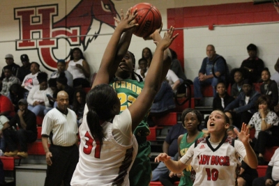 Jakerra Covington (22) pulls up for two of her 14 points during Tuesday's win at Hoke County.