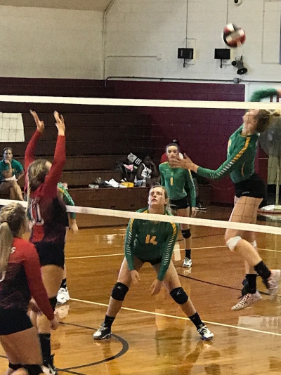 Senior outside hitter Altman Griffin spikes one of her team-high 14 kills Thursday against West Montgomery.