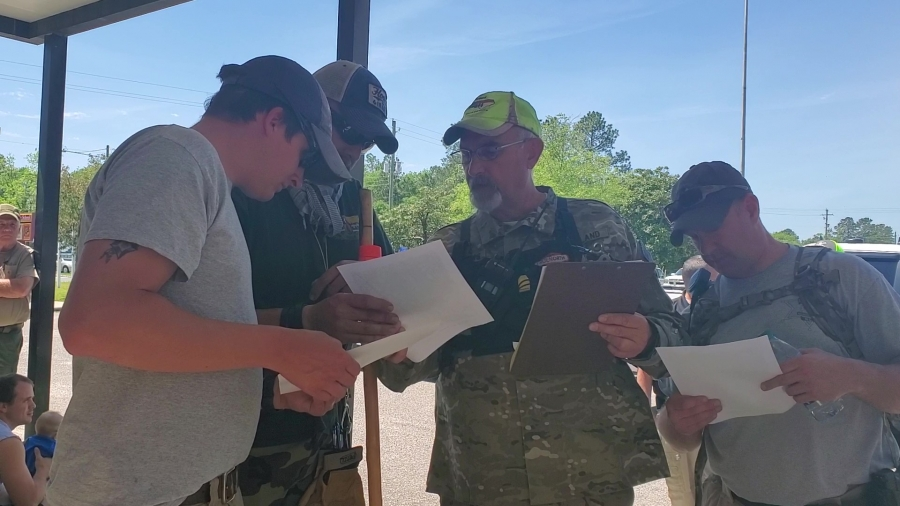 Mike Williams, center, of Pineland Search and Rescue, shows team leaders their search parameters on a map. The search for the missing man was called off Wednesday afternoon.