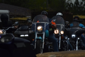 A line of motorcyle riders leave Crossroads Saloon Sunday in the Caleb Bundy Memorial Ride.