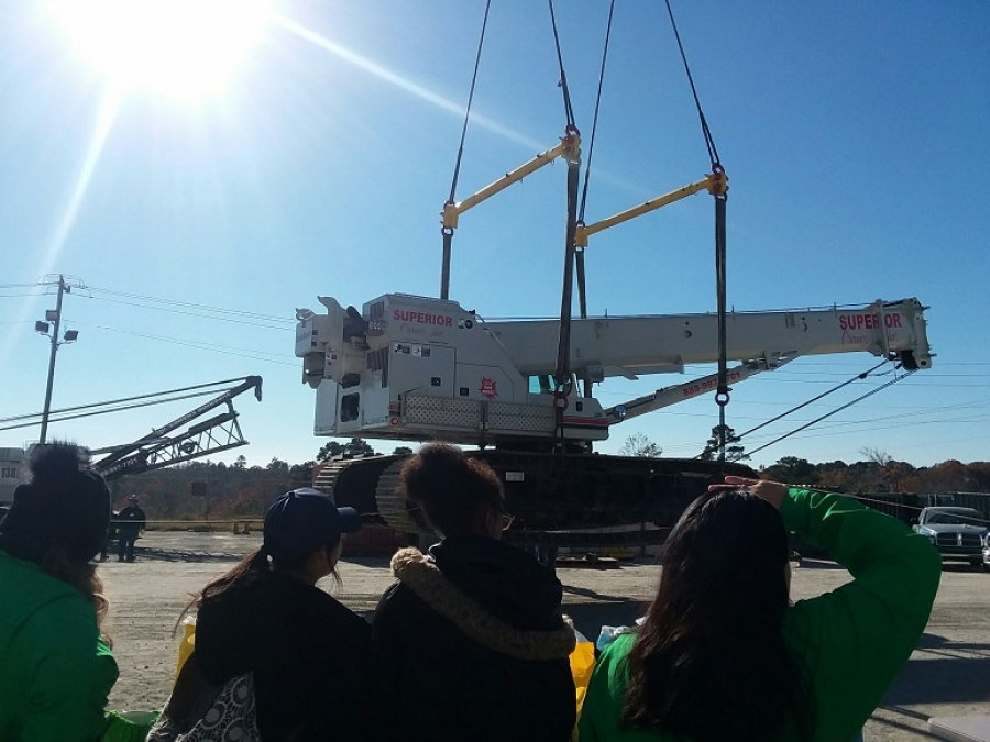 Students watch a crane demonstration at Superior Cranes for the Lift & Move event Nov. 29.
