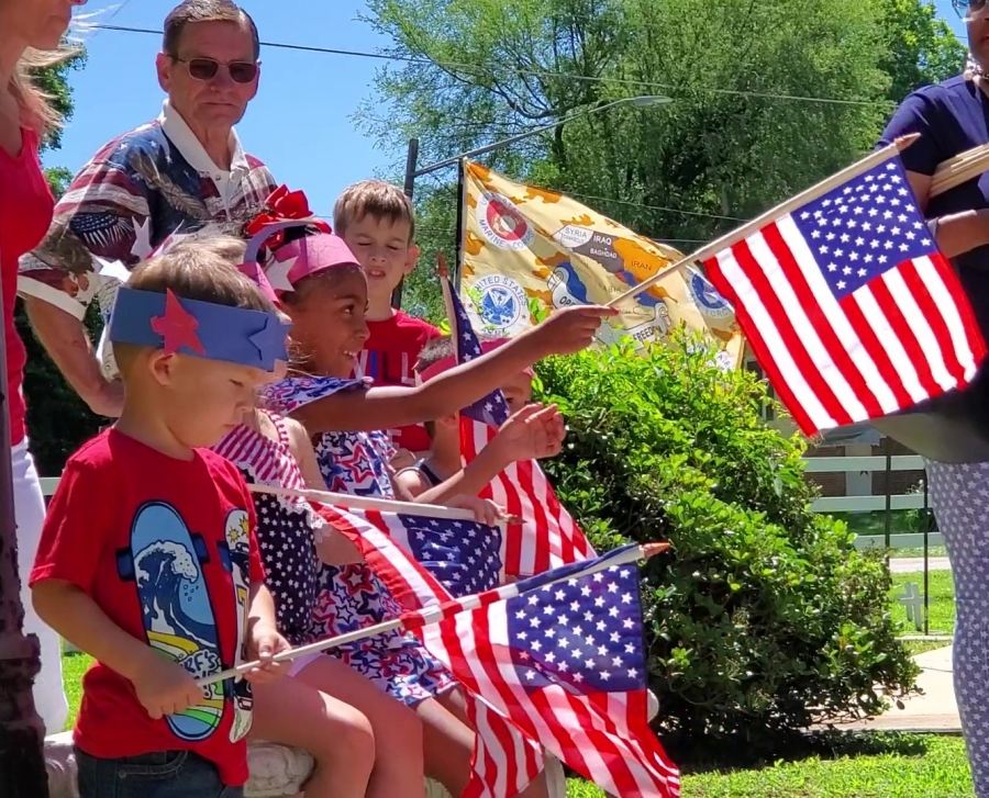Levi Merrell and Londyn Bright hold small U.S. flags during a Flag Day event Friday at VFW Post 4203 and Veterans Memorial Park.