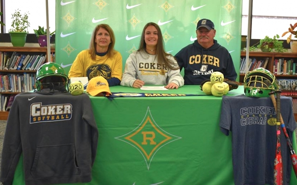 Kayla Hawkins (center) is joined by her parents Becky and Keith Hawkins during her official signing day on Wednesday.