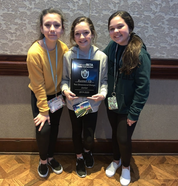 Brianna Bouldin, Karley Simmons and Macy Frye pose with their second-place plaque for 2-dimensional design.