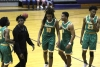Nygie Stroman (10) is congratulated by teammate Caleb Hood after hitting the game-winning bucket Friday at Jack Britt.