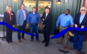 Several community members cut the blue ribbon to symbolize the official opening of Ellerbe's AGInnovation Center (Left to right: Susan Kelly, Kenneth Robinette, Lee Berry, Dan Gerlach, Davon Goodwin and Senator McInnis)