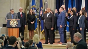 Richmond County Sheriff James Clemmons, along with 17 other members of the justice community, are sworn in to the Presidential Commission on Law Enforcement and the Administration of Justice on Wednesday.
