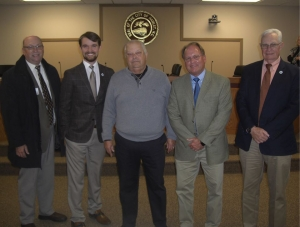 Hamlet Councilman and former Rockingham police chief Eddie Martin was honored Tuesday night by Richmond Community College with the announcement of a scholarship in his name. From left, RCC President Dr. Dale McInnis, City Manager Jonathan Blanton, Martin, RCC Vice President of Development Hal Shuler, Mayor Bill Bayless.