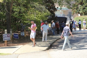 Voters line up for early voting Thursday, Oct. 16, at the Lake Lynn Community Center in Raleigh.