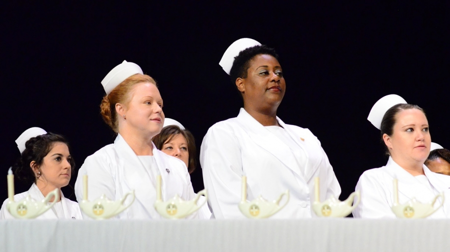 Practical Nursing graduates take the Nurse's Oath during a pinning ceremony at Cole Auditorium on Tuesday. See more photos and video on the RO's Facebook page.