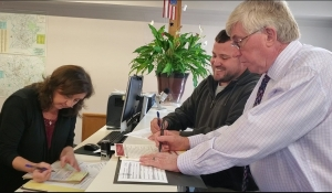 Elections Director Connie Kelly checks paperwork Monday after Ben Moss files to run for the N.C. House of Representatives and Tom McInnis files to retain his seat in the state Senate.