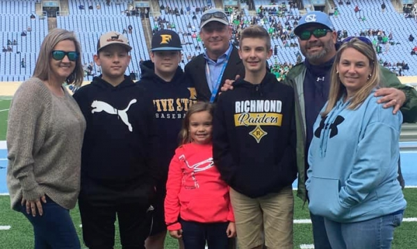 Dan Wright (back row, center) was joined by friends and family as he officiated Saturday's 4A state championship game.