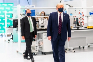 President Trump, foreground, and U.S. Health and Human Services Secretary Alex Azar visit the Fujifilm Diosynth facility in Research Triangle Park July 27, 2020.
