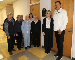 Bobby Dole and his wife, Tonya, (far right) are pictured with Andre Nadeau's 100-year-old widow and a host of family members.