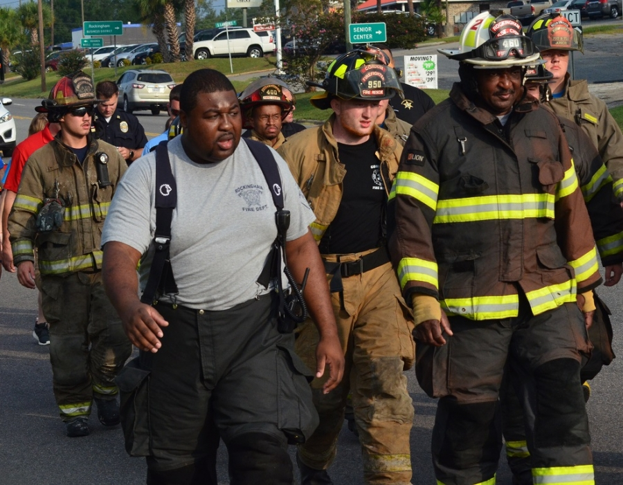 First responders from across Richmond County begin a 3-mile trek from the old courthouse to Walmart in remembrance of 9/11 victims. See more photos on the RO's Facebook page.
