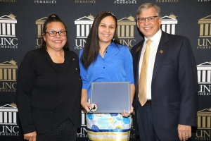 UNCP senior Denise Salvetti (middle) poses with keynote speaker Donna Chavis and Chancellor Robin Gary Cummings.