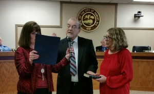 Terry Moore, former chief of the Hamlet Police Department, is sworn in as a City Council member Dec. 10.