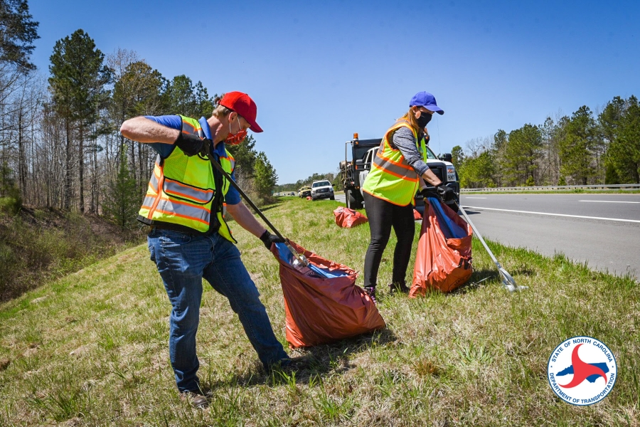 N.C. Board of Transportation Division 8 Representative Lisa Mathis and Division Engineer Brandon Jones pick up trash with a crew Tuesday along U.S. 421 Bypass in Sanford.