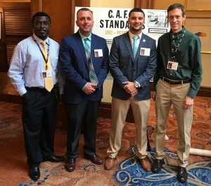 School of Business professors Drs. Cliff Mensah (left) and John Parnell (far right) pose with UNCP seniors Joey Bartch and Josh Brooks at the 2019 Association of Private Enterprise Education International Conference.