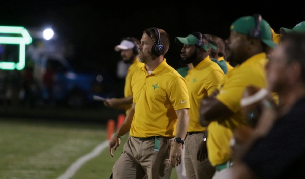 "Raiders head coach Bryan Till (center) will host the first ""State of the Program"" community meeting Thursday, February 22, at 6 p.m. in the RSHS cafeteria."