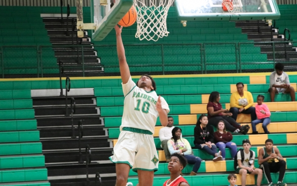 Sophomore Deshon Watson lays in two of his 11 points in Saturday's win over South Meck.