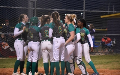 The Lady Raiders greet Payton Chappell at home following her solo homer in the top of the fifth inning.