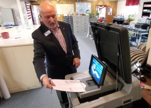 Tom Janyssek from Printelect demonstrates a high-tech voting machine to the Richmond County Board of Elections on Tuesday.