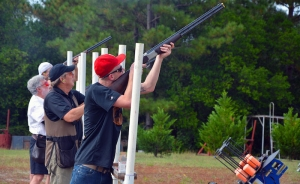 "Participants in the ""flurry"" fire away at skeets being discharged by six skeet throwers in attempt to hit as many as they can in two and a half minutes."