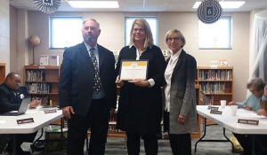 Dawn Terry, principal of Fairview Heights Elementary, center, stands with Richmond County Board of Education Chairman Wiley Mabe and Superintendent Dr. Cindy Goodman after being presented a certificate for her school exceeding academic growth.