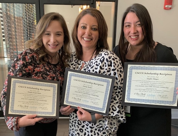 Kayla Fesperman, Emily Tucker and Taylor Player from the Richmond County Chamber of Commerce were each awarded scholarships at a recent conference.