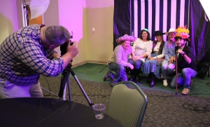 Photographer Jerry Andrews looks through the lens to make sure the shot is set for a group in the photo booth Thursday during the Richmond County Chamber of Commerce's Annual Celebration. See more photos on the Richmond Observer's Facebook page.