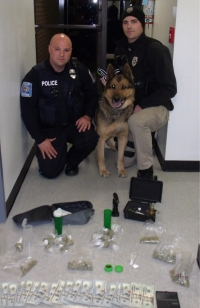 "HPD Patrolman Chad Haywood and K-9 Officer Greg Stone with Drug Dog ""Edy"" and ""Discoveries"""