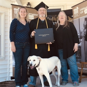 UNCP graduate Eugene Kaplan (middle) celebrates with wife, Glenna, (left) and daughter, Meggan Hollis (far right).