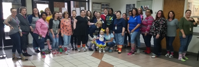 Richmond County Human Services employees pose with 2-year-old Charlotte Marks, all rocking their socks for World Down Syndrome Day. See the RO's Facebook page for video.