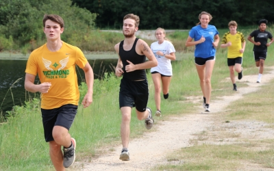 Seniors Carson Jordan and Josh Wallace are followed by senior Alena Craddock and junior Maylyn Wallace during Tuesday's workout at Hinson Lake.