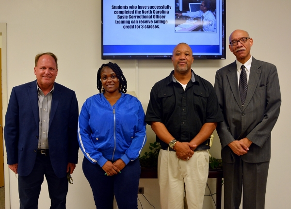 Pictured, from left to right, Dr. Hal Shuler, associate vice president of development at Richmond Community College; Kendrina Crowder, pharmacy tech graduate; Stanley Franklin, truck driver training graduate; and Douglas M. Fulford Jr., State Employees Credit Union vice president city executive. Not pictured are scholarship recipients Sandy Faircloth and Veraka Sturdivant, also truck driver training graduates.