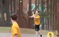 Freshman Ethan McDonald delivers a serve alongside freshman Ty Murray in the duo's 8-0 doubles win Tuesday.