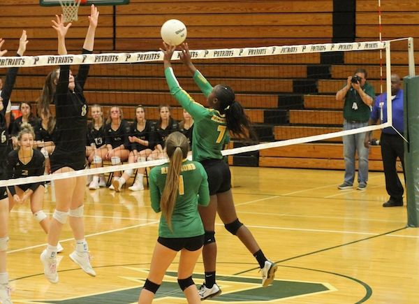 Junior Jakerra Covington tips a ball during the third set of Wednesday's SAC tournament championship match.