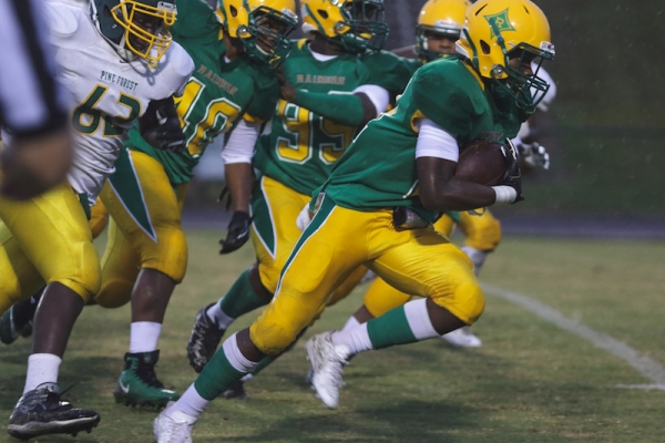 Freshman running back CJ Tillman surges ahead for the opening touchdown Thursday following a muffed Pine Forest punt.
