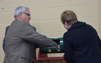 Rockingham City Manager Monty Crump pulls the winning ticket for the grand prize during the city's annual employee appreciation dinner Thursday.