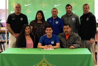 Carlos Alcocer (front row, center) signed to play for St. Andrews University on Friday.