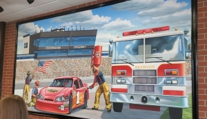 The dining room of Firehouse Subs in Rockingham, which opened Thursday,features a hand-painted mural by Chief Mural Artist Joe Puskas of a Firehouse race car with a pit crew of firemen — including one waiving an American flag — and a Rockingham Fire Department truck on the track at Rockingham Speedway.